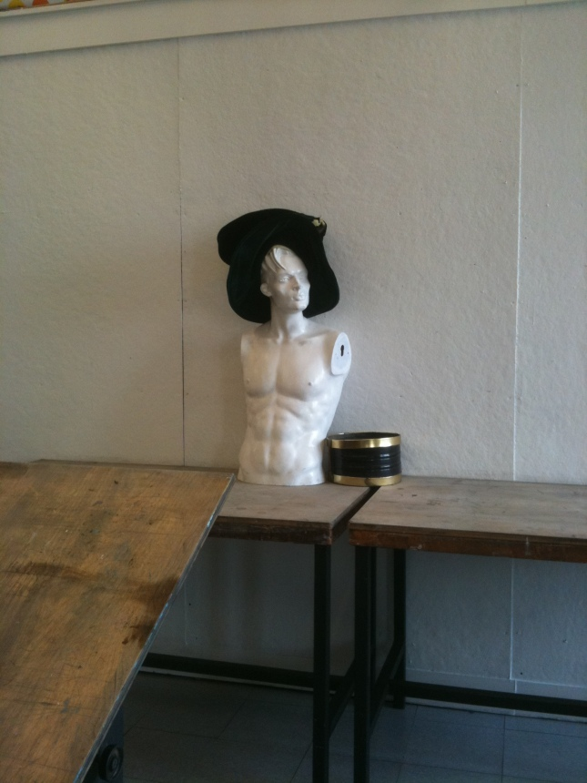 "A Plaster of a Man's Head and Torso, wearing a velvet ""Mad hatter"" style hat"